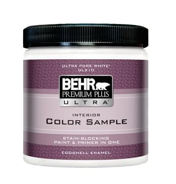 closeup of a behr paint sample can in with a purple horizontal stripe label