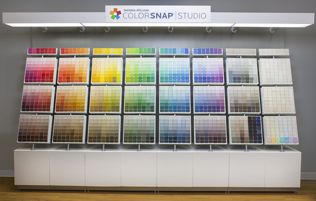 sherwin williams paint chip display from red through white inside of a store