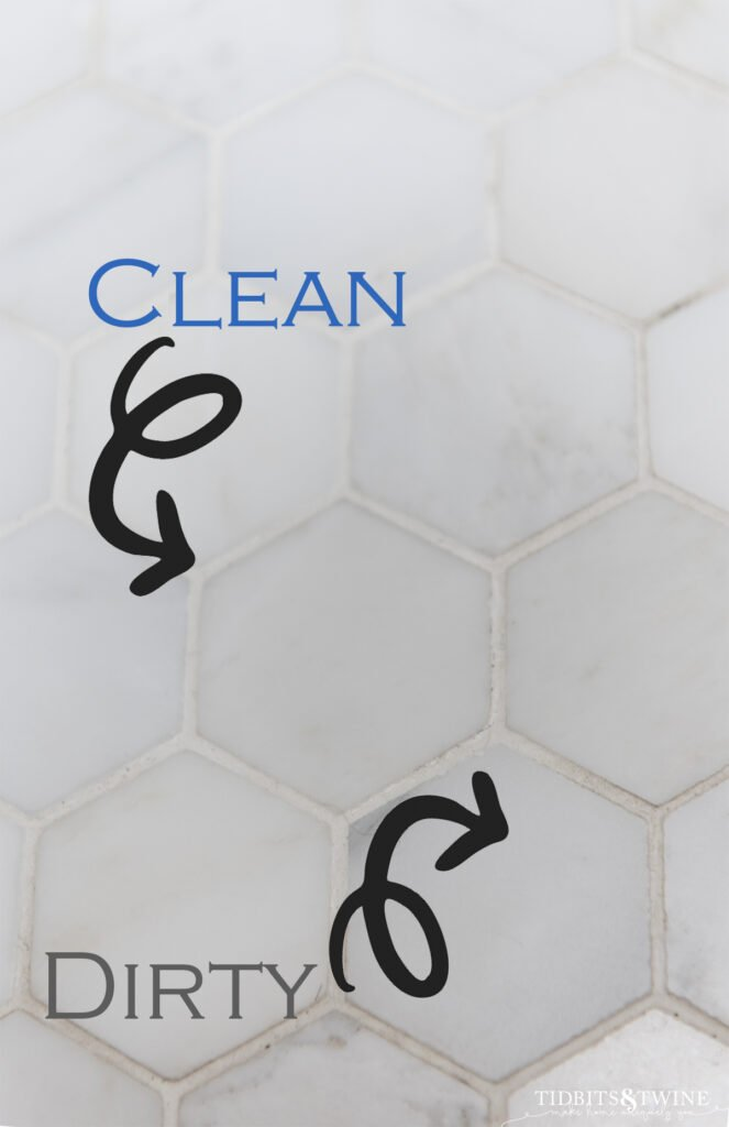 closeup of two inch hex carrara marble with white grout showing which grout is clean and which is dirty