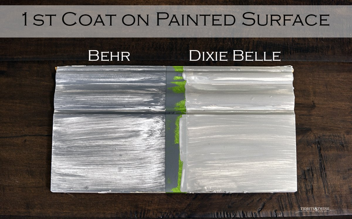 board sectioned in two one painted with behr chalk paint and one dixie belle showing coverage on 1st coat of paint