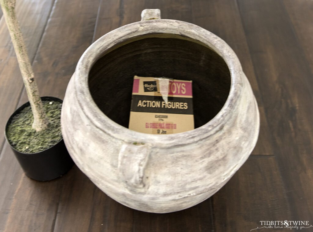brown clay pot with box in the bottom to use as a riser for artificial plant