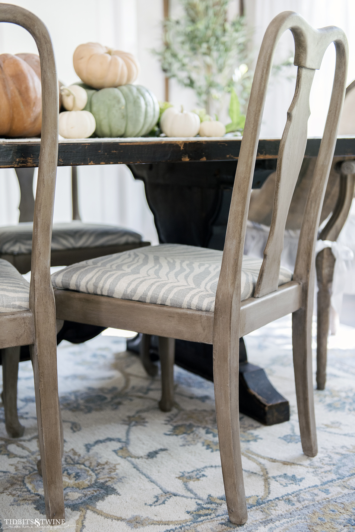 refinished gustavian dining chair with faux wood finish and modern zebra print on chair seat in french dining room